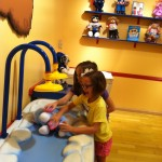 Lily helping Kendall wash her new bunny!
